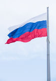Flag of Russia. Fluttering on wind against sky Royalty Free Stock Image