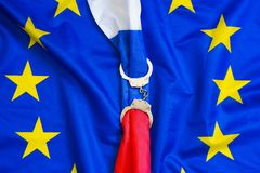 European Union. The concept of sanctions for Russia. Flag of Russia in Handcuffs on the background of the flag of the European Union. European Union sanctions royalty free stock photography