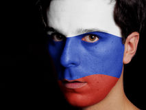 Flag of Russia. Painted on a Face of a Young Man Stock Photography
