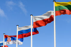 Flag of Russia, Poland and Lithuania on the background of the sk Stock Photo
