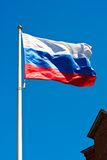 Flag of Russia. Russian flag on  background of blue sky Royalty Free Stock Image