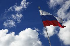 Flag of the Russia on the sky background Royalty Free Stock Image