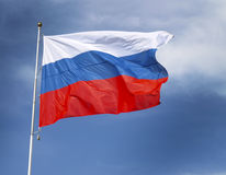 Flag of Russia. Tricolor flag of Russia against the blue sky Royalty Free Stock Photos