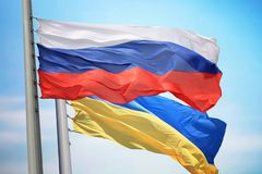 Flag of Russia and Ukraine. Against the background of the blue sky royalty free stock image