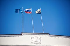 The flag of Russia and the Ulyanovsk region. Flags of Russia and Ulyanovsk region on the roof of the government building royalty free stock image