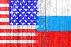 Flag of Russia and USA painted on the wooden board. Arms race and rivalry. Stock Photography