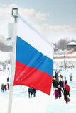 Flag of Russia on wind at winter cloudy day Royalty Free Stock Images