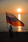 Flag of the Russian Federation. Against the sunset Stock Photography