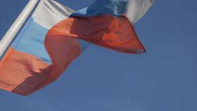 Flag of Russian Federation against blue sky stock footage