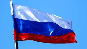 Flag of the Russian Federation against the blue sky.  royalty free stock photos