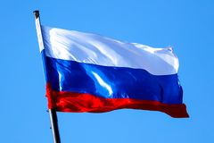 Flag of the Russian Federation against the blue sky.  stock images