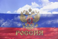 Flag of the Russian Federation a background of blue sky and clouds. Closeup Stock Images