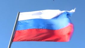 The flag of the Russian Federation is developing in the wind on the blue sky. 1920x1080. full hd. slow motion. The flag of the Russian Federation is developing stock video