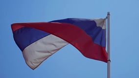 Flag of the Russian Federation. The Russian flag develops highly on a wind in slow motion. Close up stock video