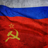 The flag of the Russian Federation and the USSR on the background of a concrete wall.  stock images