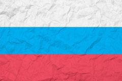 Flag Of Russian Federation. Vintage style. Old wall texture. Faded background. Stock Photos