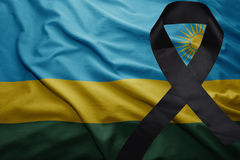 Flag of rwanda with black mourning ribbon Royalty Free Stock Photo