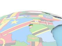 Flag of Rwanda on bright globe. Rwanda on political globe with embedded flags. 3D illustration Royalty Free Stock Images