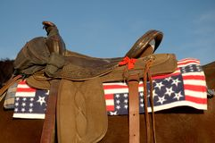 Flag Saddle Pad. Close-up of a horse saddled up with a flag pad under the saddle Royalty Free Stock Photo