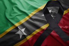 Flag of saint kitts and nevis with black mourning ribbon Royalty Free Stock Image