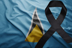 Flag of saint lucia with black mourning ribbon Stock Image