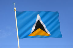 Flag of Saint Lucia - Caribbean. The flag of the Caribbean island of Saint Lucia was adopted on March 1 1967. The triangles represent the island's famous twin Stock Photos