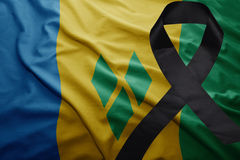 Flag of saint vincent and the grenadines with black mourning ribbon Royalty Free Stock Photo