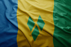 Flag of Saint Vincent and the Grenadines. Waving colorful national Saint Vincent and the Grenadines flag Royalty Free Stock Photos