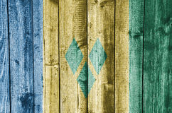 Flag of Saint Vincent and the Grenadines on weathered wood Stock Photography