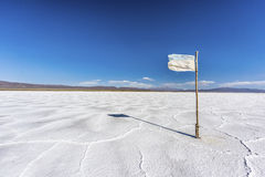Flag on the Salinas Grandes in Jujuy, Argentina. Royalty Free Stock Photo