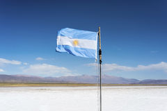 Flag on the Salinas Grandes in Jujuy, Argentina. royalty free stock images