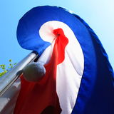 Flag salute. Flag waving in the wind on a bright day Stock Photo