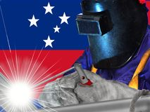 Samoan welder. The flag of Samoa was officially adopted on January 1, 1962. The symbolic flag display the white stars of the Southern Cross. The blue is said to royalty free stock image