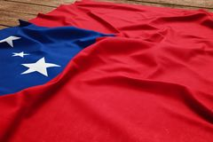 Flag of Samoa on a wooden desk background. Silk Samoan flag top view.  stock photography