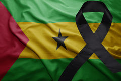 Flag of sao tome and principe with black mourning ribbon Royalty Free Stock Photo