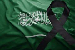 Flag of saudi arabia with black mourning ribbon. Waving national flag of saudi arabia with black mourning ribbon Royalty Free Stock Photos