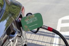 Flag of Saudi Arabia on the car`s fuel filler flap. stock photography