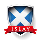 Flag of Scotland with Islay sign on ribbon Royalty Free Stock Photos