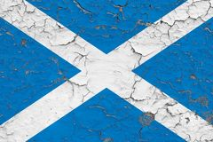 Flag of Scotland painted on cracked dirty wall. National pattern on vintage style surface vector illustration