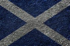 Flag of Scotland painted on asphalt. Flag of Scotland painted on grainy asphalt royalty free stock photo