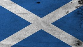Flag of Scotland on wooden plate background. Grunge Scotland flag texture. Flag of Scotland on wooden plate background. Grunge Scotland flag texture, it is a stock images