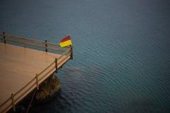 Flag on a sea platform. A flag on a deserted sea platform during a mild storm. Kas, a summer resort in Turkey Stock Photography