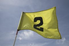 Flag on the second hole Stock Images