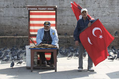 Flag Seller and Bird Feeder in Istanbul stock photo