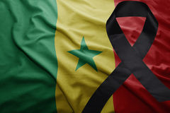 Flag of senegal with black mourning ribbon Stock Photo
