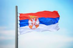 Serbian flag. Flag of Serbia against the background of the sky royalty free stock photo