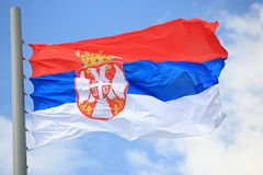 Flag of Serbia. Against the sky Royalty Free Stock Photography