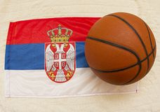 Flag of Serbia with basketball ball. Serbia is very famous in the world of basketball stock photography