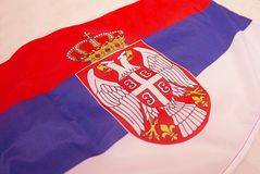 Flag of Serbia..2019. Flag of Serbia.Flag on a light background.Red, blue and white.There are two eagles on the flag and a crown on them royalty free stock image