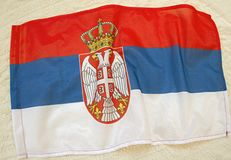 2019.Flag of Serbia. Flag of Serbia.Flag on a light background. Red, blue and white.There are two eagles on the flag and a crown on them royalty free stock image